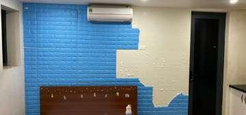 Thợ tháo xốp dán tường